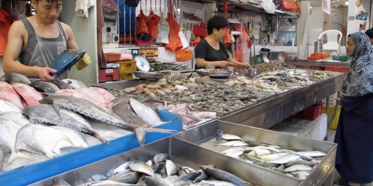 Fishmonger at Tekka Market